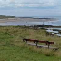 NU2132 : Seat overlooking the beach at Seahouses